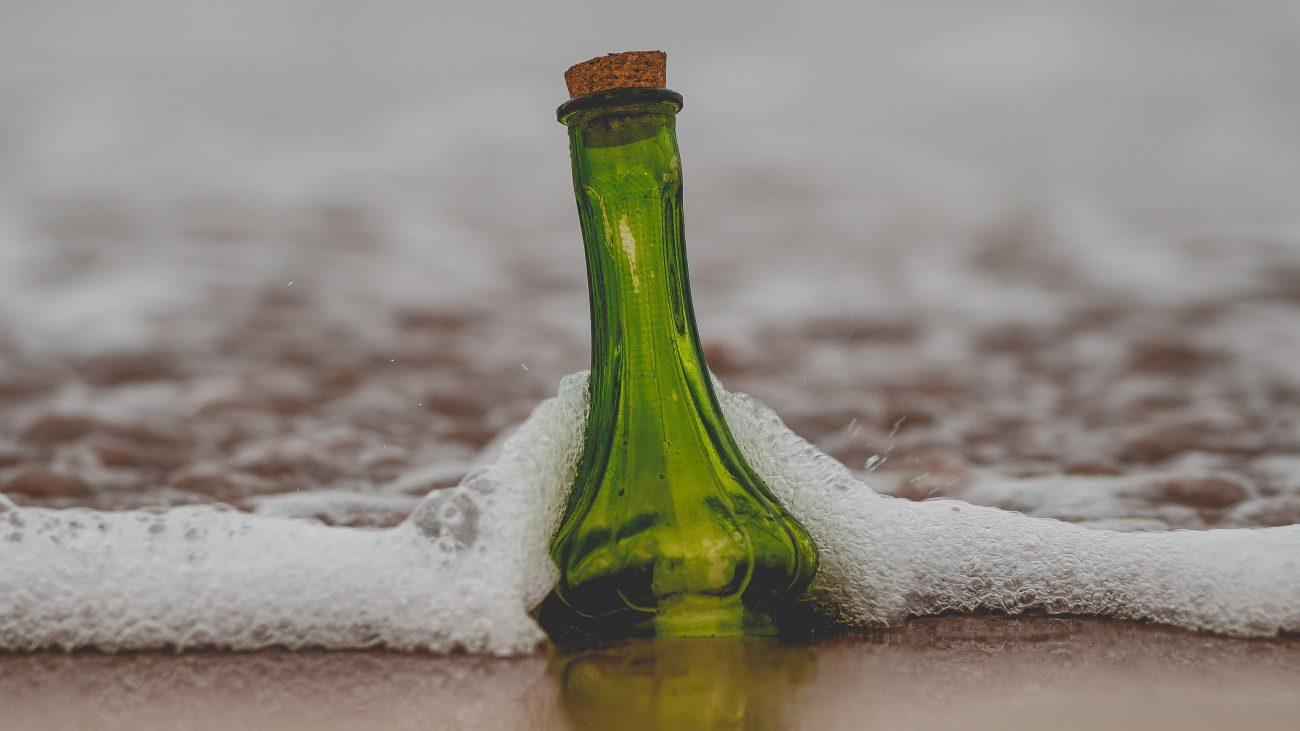 message in bottle on seashore