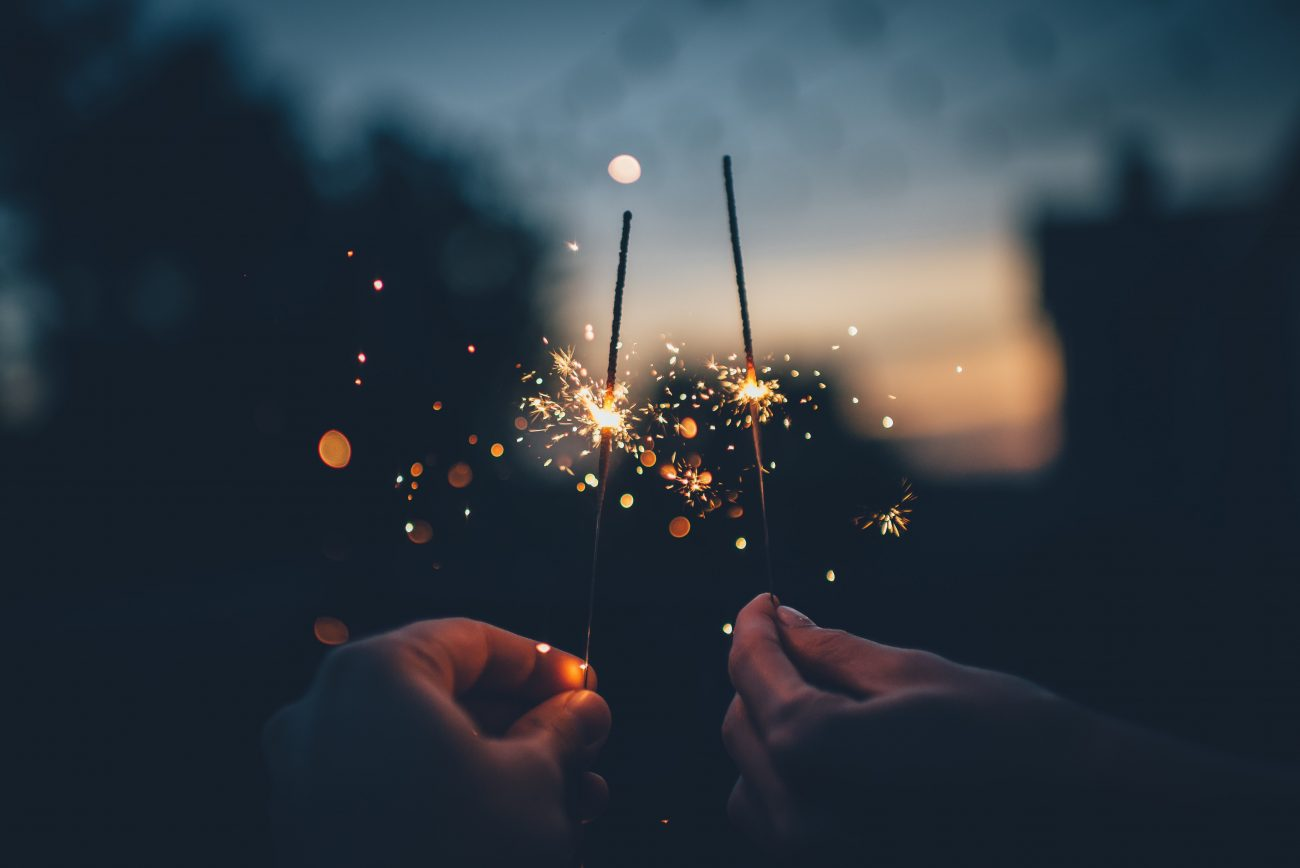 sparklers at night in hands