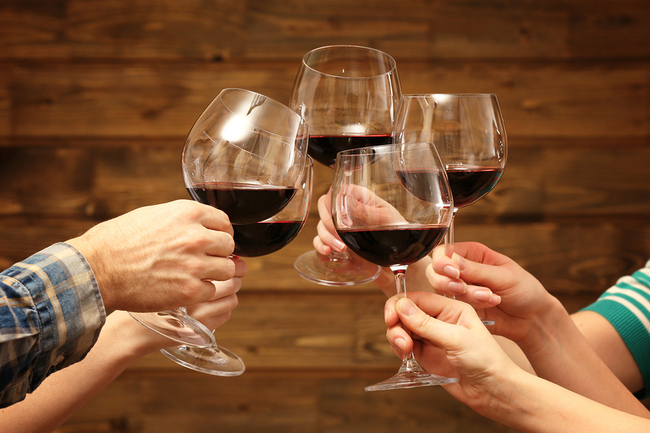 bigstock-Clinking-glasses-of-red-wine-i-83308853.jpg