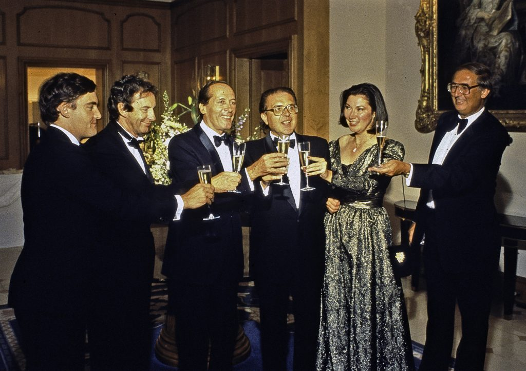 Vintage image of people toasting with sparkling wine